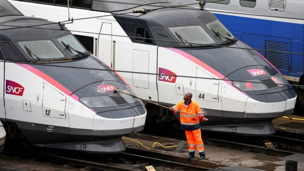 A worker washes a train in Charenton-le-Pont near Paris, France, 31 May