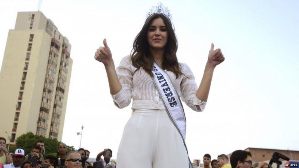 Miss Universe defends keeping crown despite Trump row - BBC News