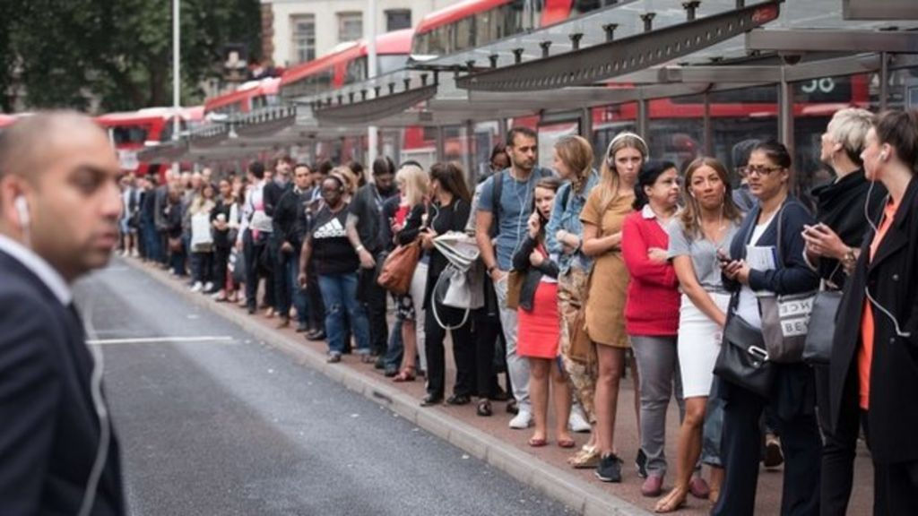 Commuters queue for buses on 6 August