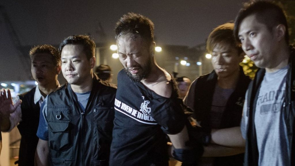 Hong Kong police officers jailed for beating protester