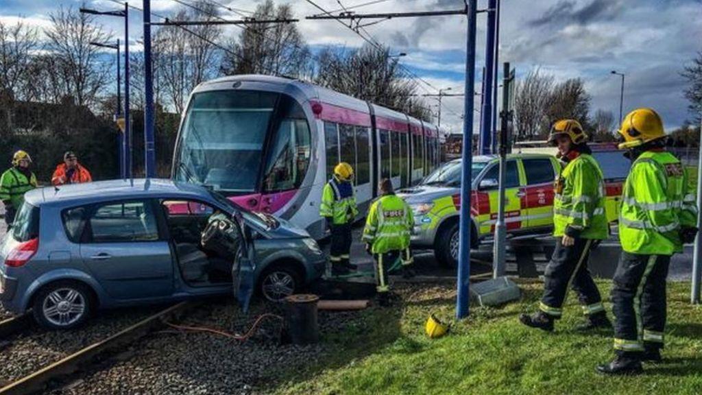 Car and tram crash