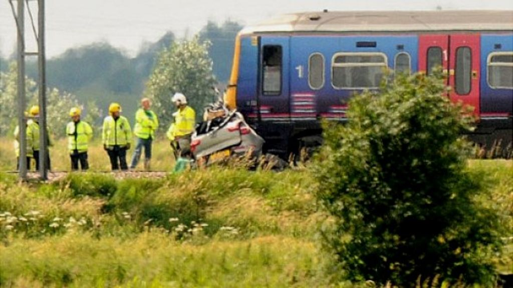 """Car under front of train following crash at """"user-worked"""" crossing near Downham Market"""