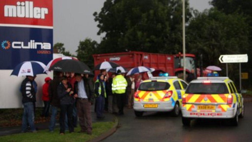 Dairy farmers blockade Muller factory at Market Drayton - BBC News