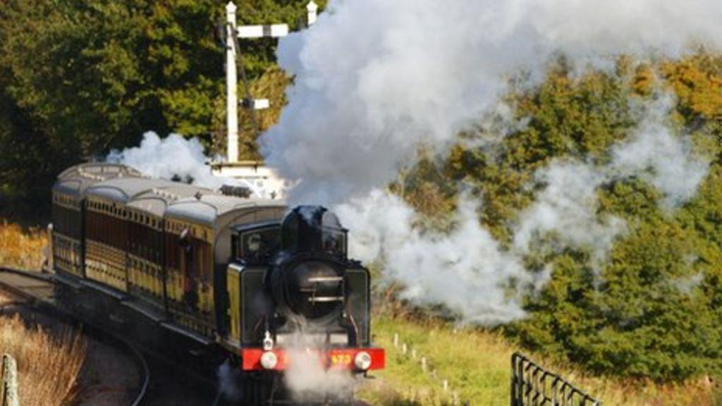 Steam engine carries Bernard Holden's coffin along the Bluebell Railway
