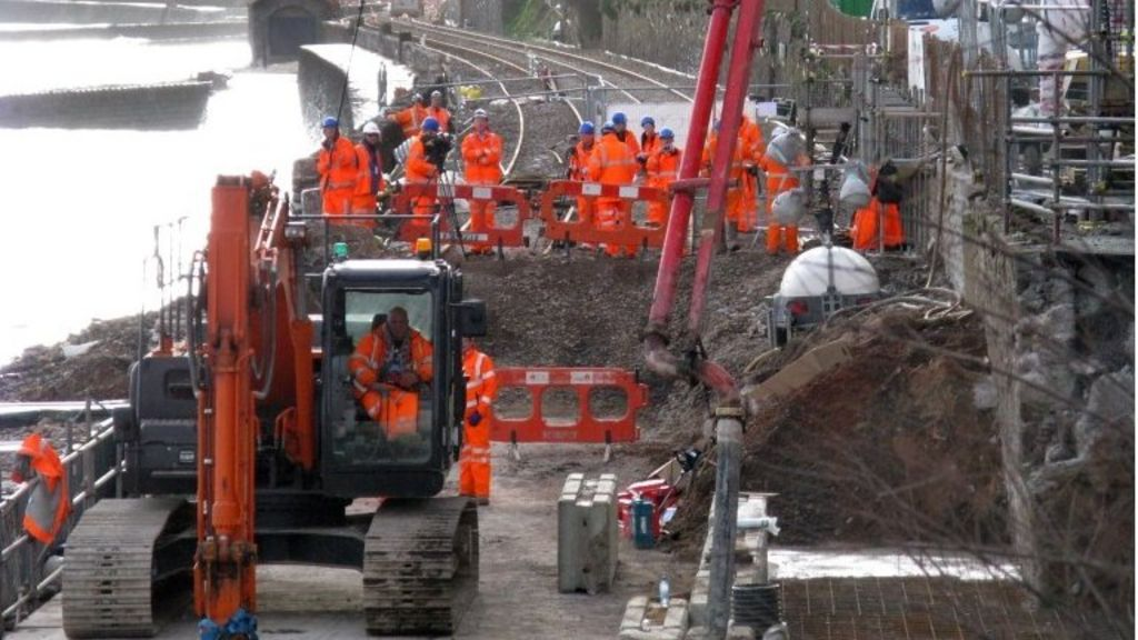 Network Rail workers conducting repairs of the railway line in Dawlish