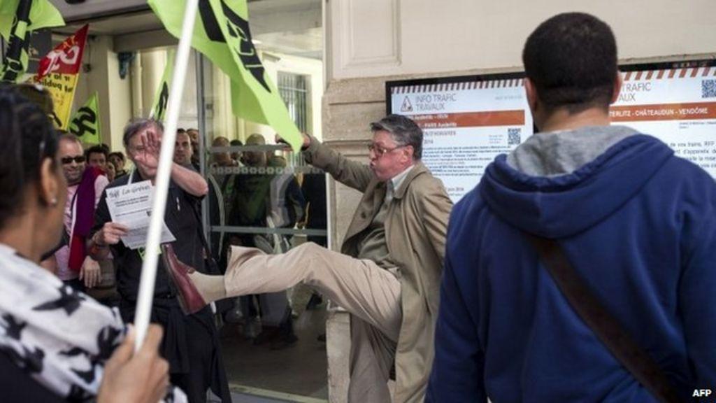 Man kicking striking rail workers