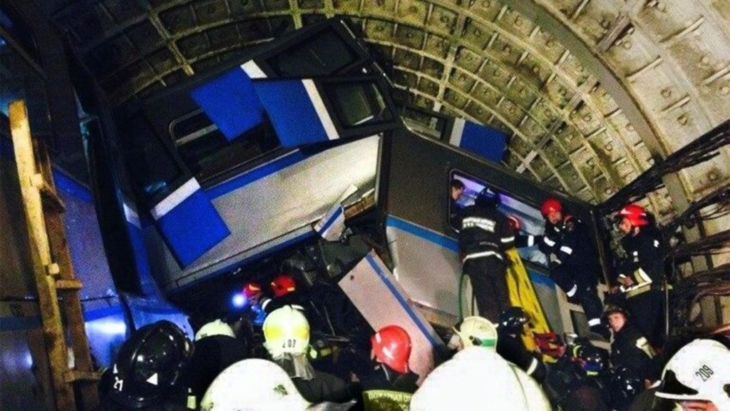 Rescue workers at the crash site in the Moscow metro, 15 July