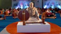 Mr Modi with traditional cotton spinning wheel