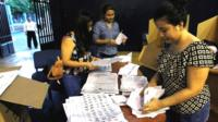 Poll workers count ballots at a polling station in Guayaquil, Ecuador February 19, 2017.