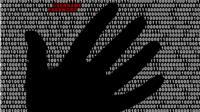 hand on computer screen