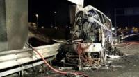 """A handout photo made available by Vigili del Fuoco (Italian Firewatchers) shows a burned Hungarian bus after an accident at """"Verona Est"""" highway""""s exit in Verona, Italy, 21 January 2017"""