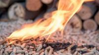 Burning wood pellets