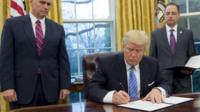 Mr Trump signed three orders on his first Monday morning as president