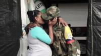 Pregnant Farc fighter kisses her husband