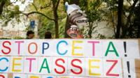 "A placard reading ""Stop CETA - it""s enough"" during an anti-CETA protest in front the Walloon parliament in Namur, Belgium"
