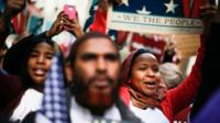 """People take part in a rally called """"I Am A Muslim Too"""" in a show of solidarity with American Muslims at Times Square on 19 February 2017 in New York City"""