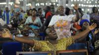 Worshippers pray into the New Year during the crossover watch night church service at the Redemption Camp on Lagos Ibadan highway on Janauary 1, 2014.