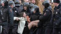 Olga Lozina being arrested in Moscow