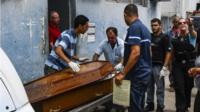 A relative makes the identifiaction of a body at the Institute of Legal Medicine in Vitoria, Espirito Santo, Brazil, 07 February 2017,