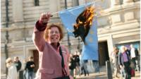 Hazel Prowse burns an EU flag outside the Methodist Central Hall on October 22, 2011 in London, England, following a campaign meeting calling for a UK referendum on membership of the EU