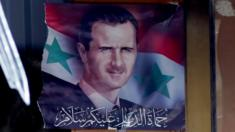 Damaged portrait of Bashar al-Assad