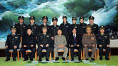 North Korean leader Kim Jong-Il (front row-C) and his son Kim Jong-un (front row-2nd L) posing with Chinese officers in October 2010