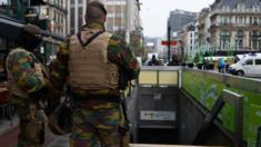 Armed soldiers patrol near Bourse metro station in Brussels. Photo: 24 November 2015
