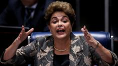 Suspended President Dilma Rousseff speaks while answering a question from a Senator on the Senate floor during her impeachment trial on August 29, 2016 in Brasilia, Brazil. Senators will vote in the coming days whether to impeach and permanently remove Rousseff from office