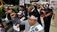 Workers from port-related organisations in Busan city shout slogans during a rally to plead with the government and creditors of Hanjin Shipping to map out measures to save the troubled shipper