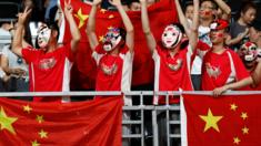 Chinese fans cheer before a men