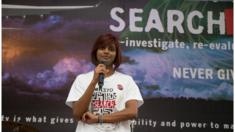 Grace Subathirai Nathan speaking at an event two years after the plane went missing.