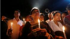 People attend a candle light vigil for the victims of the attack in Dhaka, Bangladesh