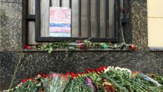 Outside the Turkish Embassy in Moscow there's a heap of flowers and a hand-coloured paper flag.
