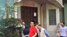 People walk past the closed Taian Table restaurant in Shanghai