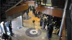 Members of special forces are seen inside the Radisson Blue Hotel in Bamako.