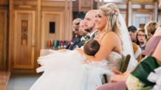 Christina Torino-Benton breastfeeds her child during her wedding ceremony.