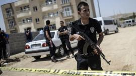Turkish police near a building where two police officers were found shot dead on 22 July