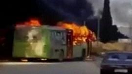 Burning evacuation bus in Syria