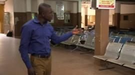 Sammy Darko in an empty admissions room in Ghana