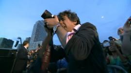 Arun Chaudhary photographing a Sanders event in NYC