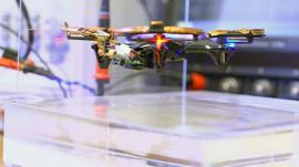 A drone being powered by wireless charging