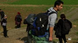 Migrants walking to the Macedonian border