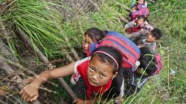 Chinese schoolchildren climbing ladder