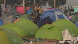 The BBC's Gavin Lee at migrant camp