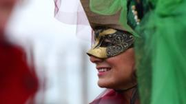 A costumed reveller smiles at St Mark's Square (Piazza San Marco) during the Venice Carnival 30 January 2016.