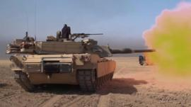 Iraqi forces tank firing shell