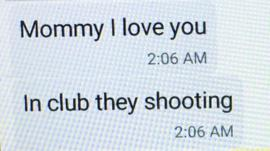 Mina Justice shows a text message she received from her son Eddie Justice at Pulse nightclub during a fatal shooting in Orlando, Fla., Sunday, June 12, 2016.
