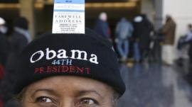 A supporter is shown with her ticket to President Barack Obamas final scheduled speech