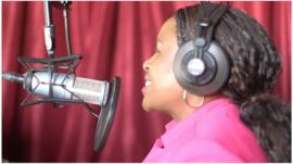 Jambo radio broadcaster at the microphone in Dallas