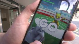 Chris Foxx with Pokemon Go game
